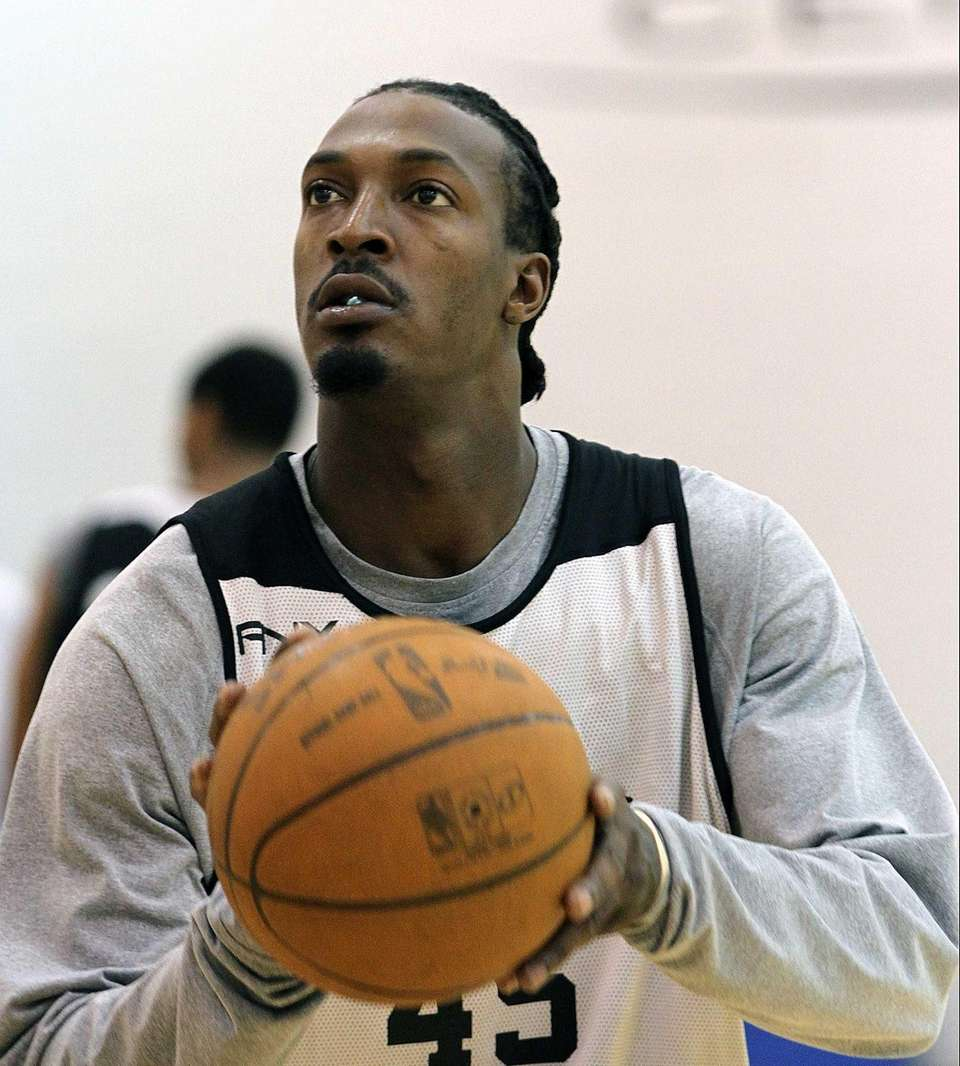 Gerald Wallace practices foul shots during practice at