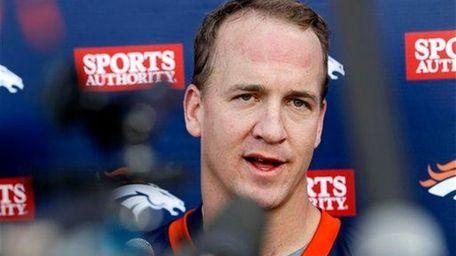 Denver Broncos quarterback Peyton Manning addresses the media