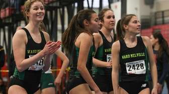 Ward Melville checks out their time after winning