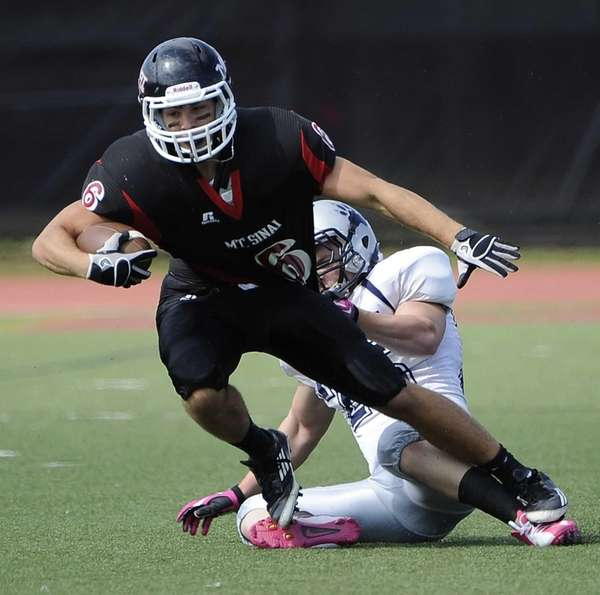 Mt. Sinai's Mike Donadio is tackled by Stony