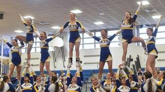 The East Meadow cheerleading team perorms during a
