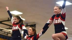 The Cold Spring Harbor cheerleading team performs during