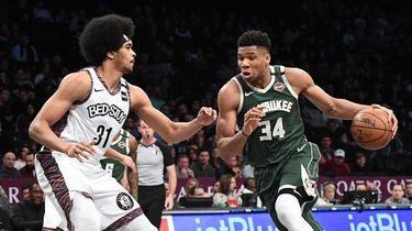 Milwaukee Bucks forward Giannis Antetokounmpo drives against Nets