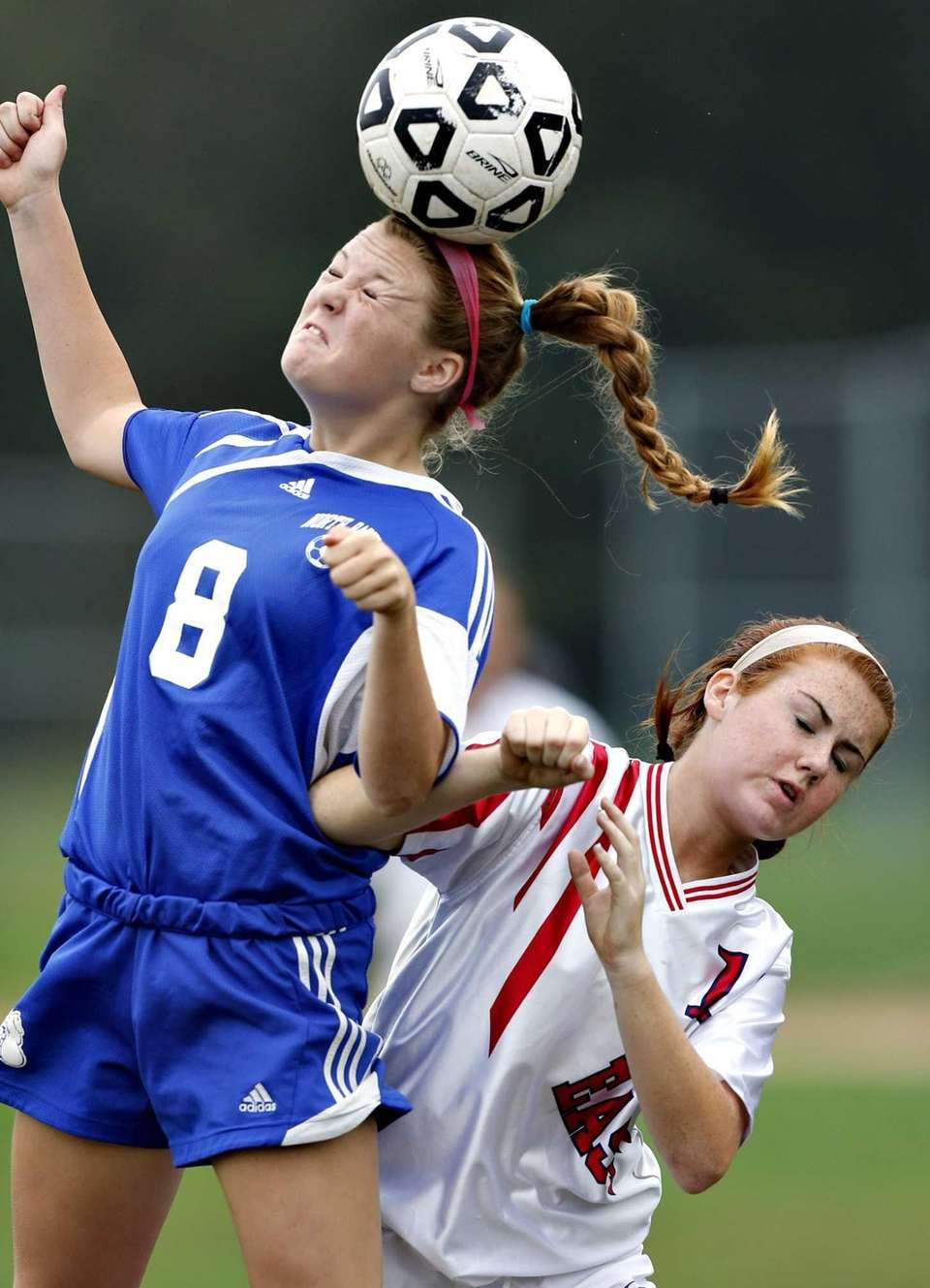 North Babylon's Dana Scheriff wins the header over
