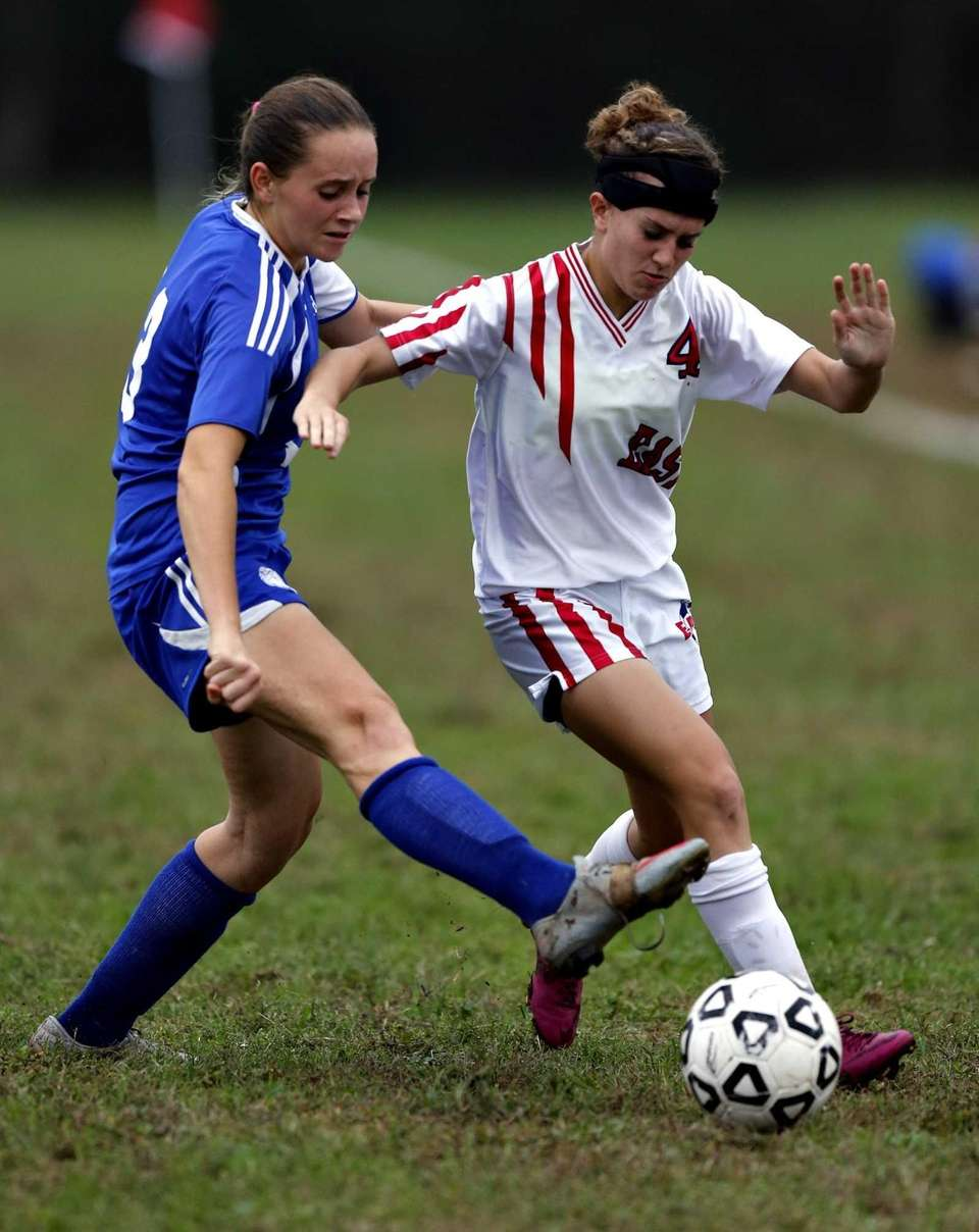 North Babylon's Alexis Rutha tries to steal the