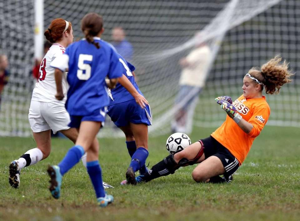 Smithtown East goalkeeper Carly Vittoria comes out of