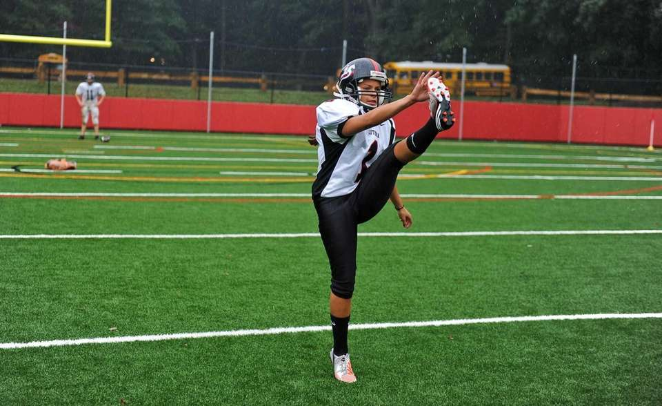 Senior kicker Carolyn Dottino-Buenahora warms up during special