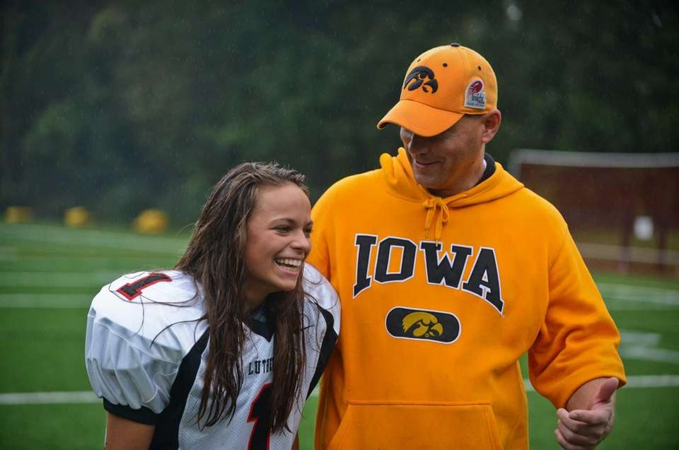 Senior kicker Carolyn Dottino-Buenahora, left, laughs with special