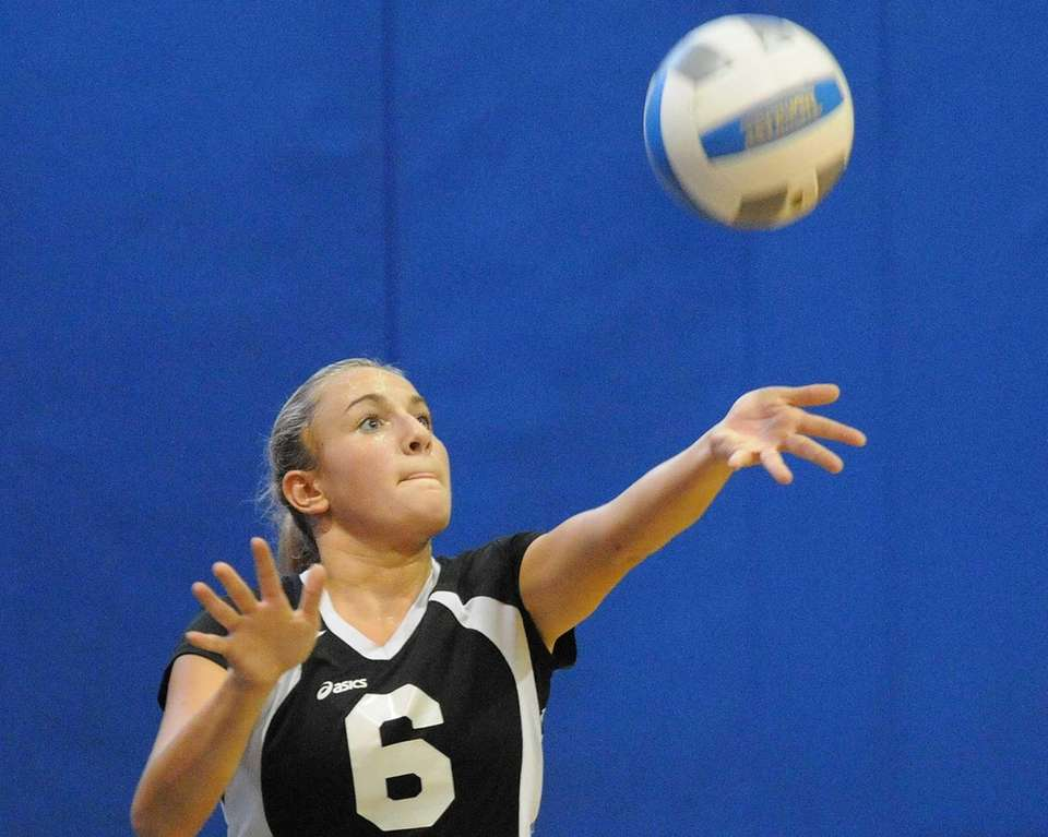 Wantagh's Carly Simeone serves a ball into play