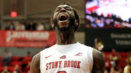 Stony Brook forward Elijah Olaniyi reacts after hitting
