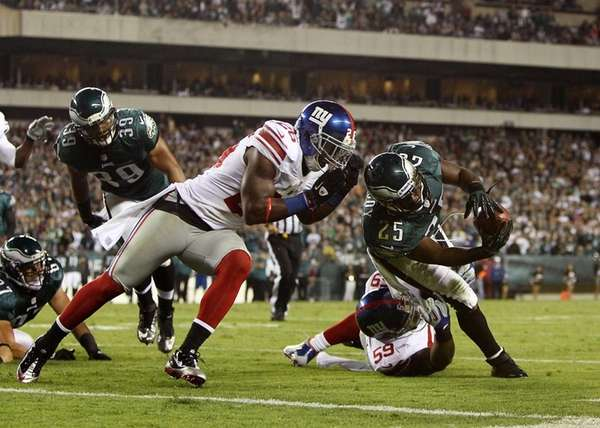 Eagles running back LeSean McCoy reaches for the