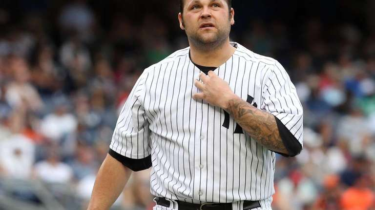 Joba Chamberlain leaves a game against the Baltimore