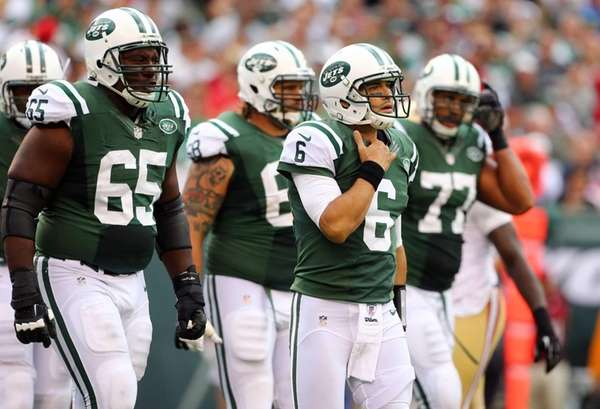 Mark Sanchez walks to the sidelines with his