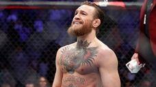 """Conor McGregor smiles after defeating Donald """"Cowboy"""" Cerrone"""