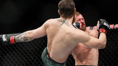"""Conor McGregor kicks Donald """"Cowboy"""" Cerrone during a"""