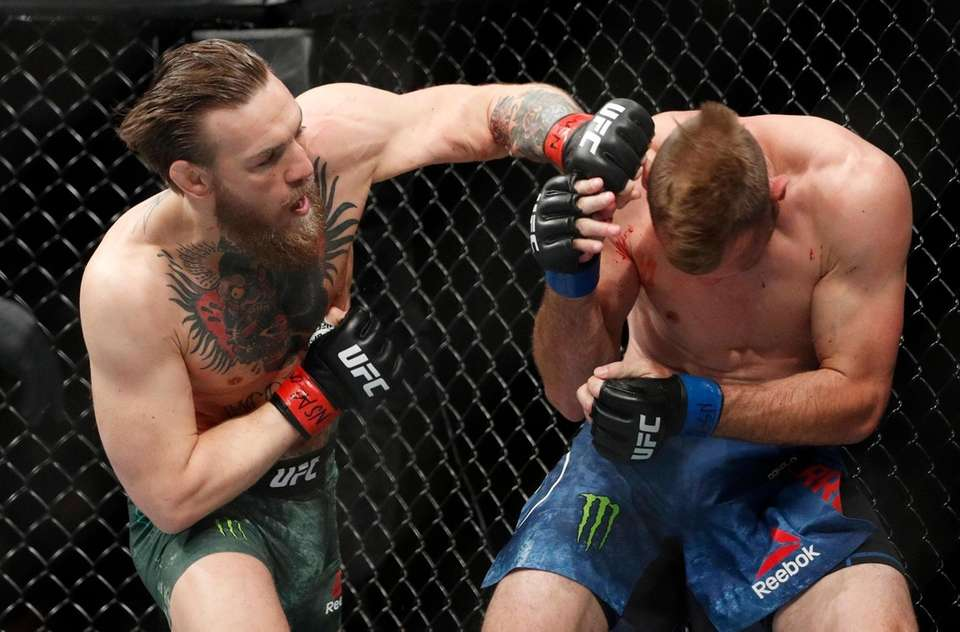"""Conor McGregor hits Donald """"Cowboy"""" Cerrone during a"""