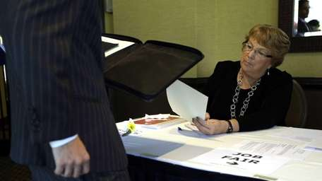 Patti Maurer of Pompano Beach, Fla., right, registers