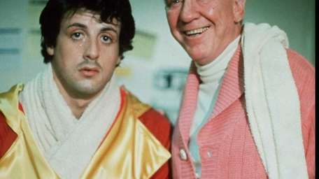 FILE-Burgess Meredith, right, is shown in this 1976