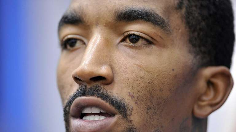 J.R. Smith talks to reporters after practice. (Oct.