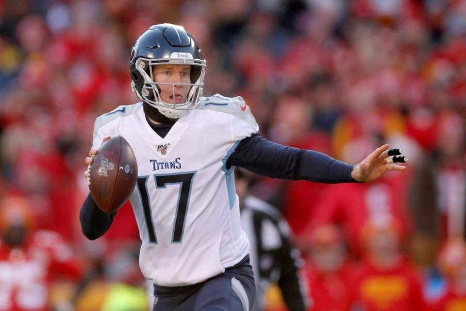 The Titans' Ryan Tannehill scrambles during the first