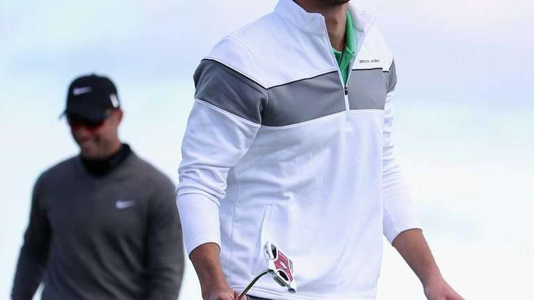 Michael Phelps reacts after putting on the ninth