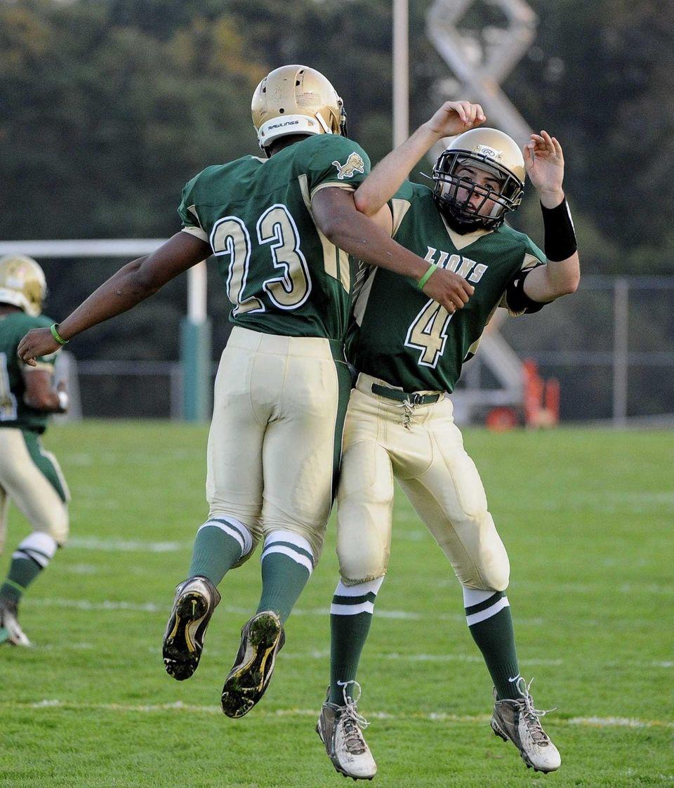 Longwood's Dashawn Taylor, left, and quarterback Kyle Corona,