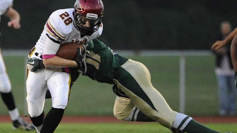 Sachem East's Kj Hill completes a reception and