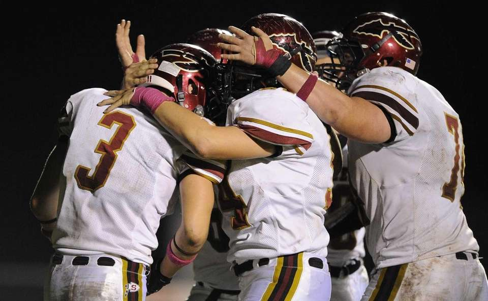 Sachem East teammates congratulate Ryan Dippel, left, on