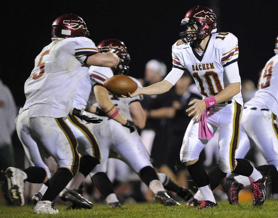 Sachem East quarterback Danny Wolff hands the ball