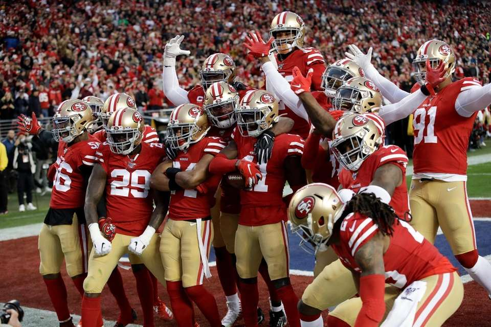 The San Francisco 49ers celebrates after interception by