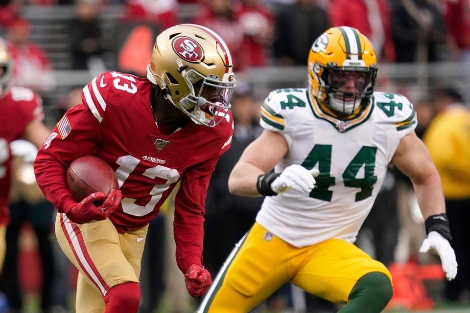 San Francisco 49ers' Richie James Jr. runs in