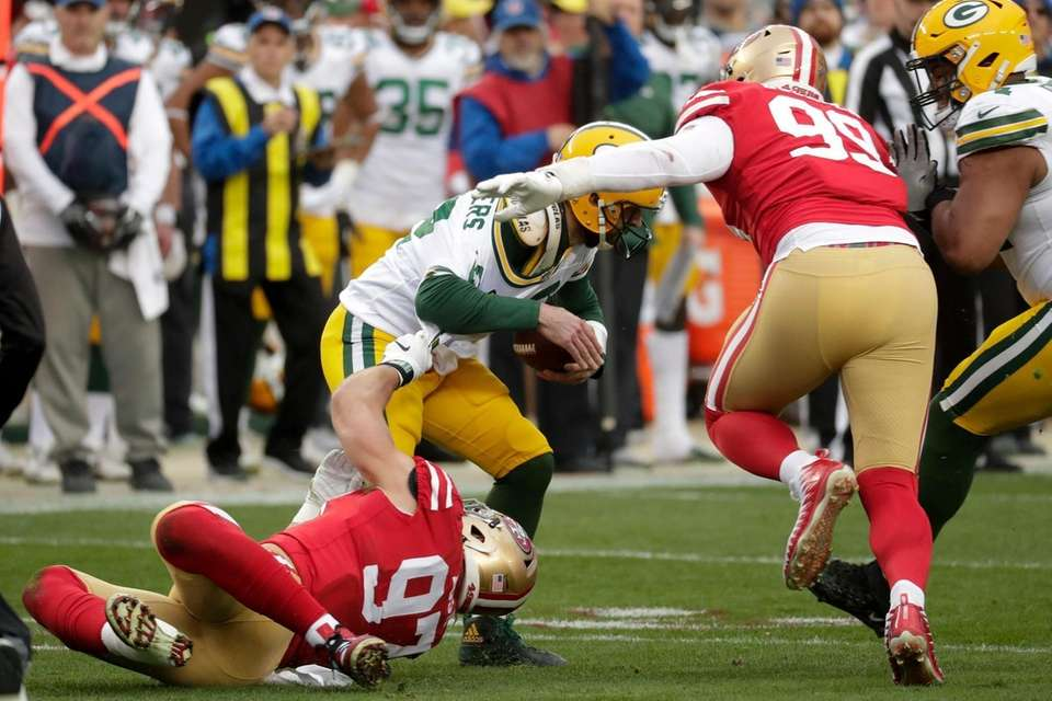 Green Bay Packers quarterback Aaron Rodgers is sacked