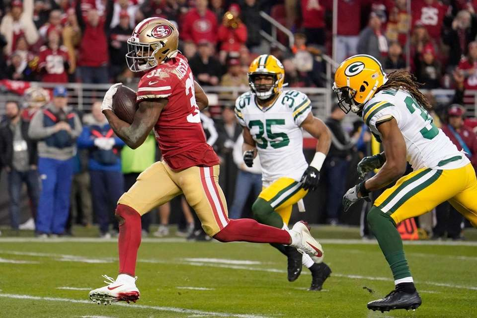 San Francisco 49ers running back Raheem Mostert runs