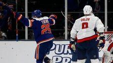 Devon Toews of the Islanders celebrates his second-period