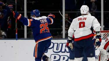 Devon Toews of the Islanders celebrates his second-period