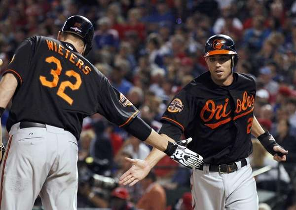 Baltimore Orioles shortstop J.J. Hardy celebrates with Matt