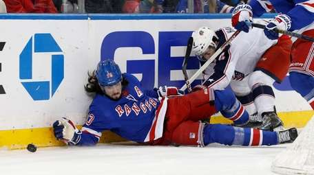 Mika Zibanejad of the Rangers battles for the
