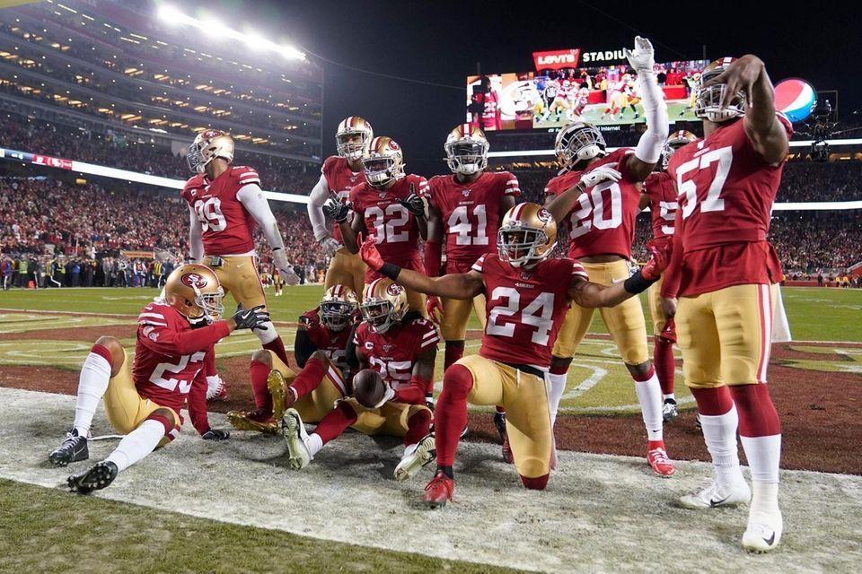 San Francisco 49ers players celebrate after cornerback Richard
