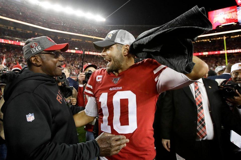 San Francisco 49ers quarterback Jimmy Garoppolo celebrates after