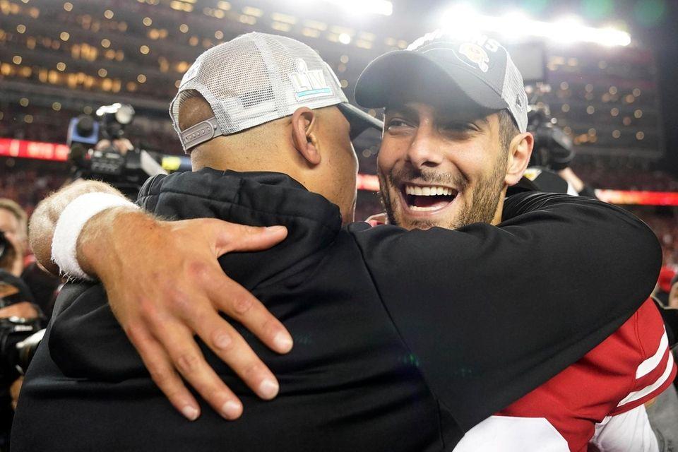 San Francisco 49ers quarterback Jimmy Garoppolo, right, celebrates