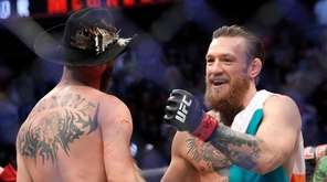 Conor McGregor hugs Donald Cerrone after his first