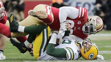 Green Bay quarterback Aaron Rodgers is sacked by