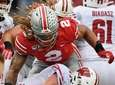 Wisconsin quarterback Jack Coan is sacked in the
