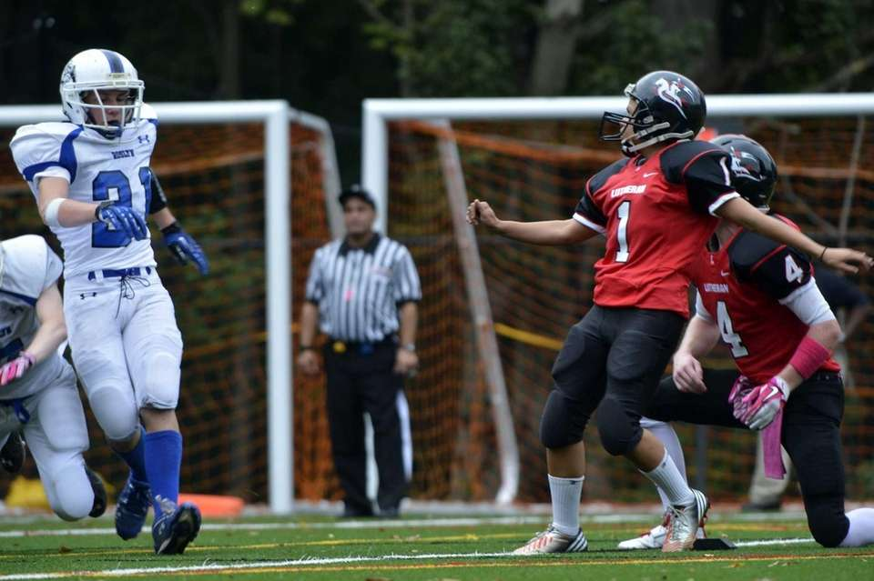 Long Island Lutheran female kicker Carolyn Dottino-Buenahora watches