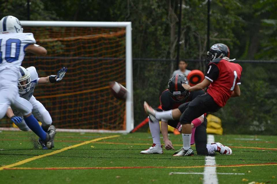 Female kicker Carolyn Dottino-Buenahora kicks a field goal