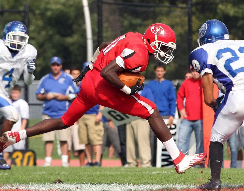 East Islip's Hugens Tranquille looks for more yardage