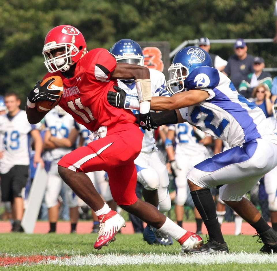 East Islip's Hugens Tranquille continues on his feet