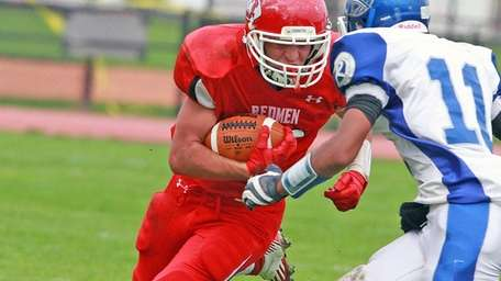 East Islip's Paul Dondero prepares for hit from