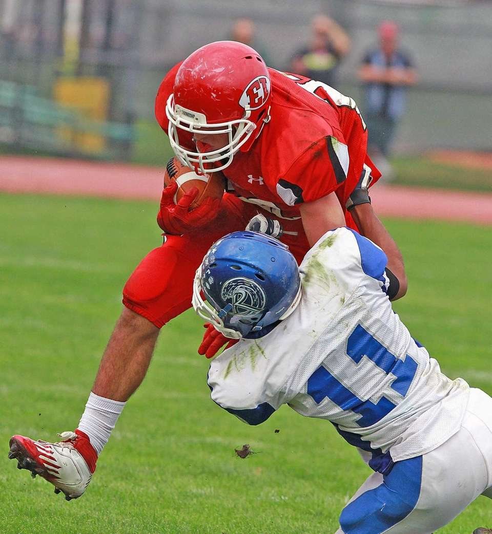 East Islip's Paul Dondero collides with Riverhead's Jaron