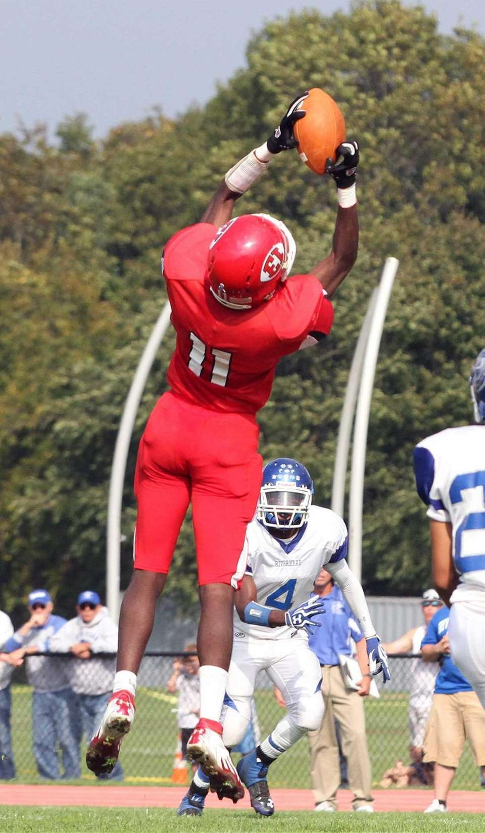 East Islip's Hugens Tranquille gets elevated for the